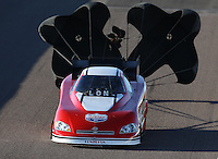 Feb. 22, 2013; Chandler, AZ, USA; NHRA funny car driver Phil Burkhart Jr during qualifying for the Arizona Nationals at Firebird International Raceway. Mandatory Credit: Mark J. Rebilas-