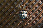 Sun face decoration on lattice panels