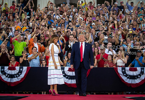 """U.S. President Donald Trump and First Lady Melania Trump arrive during the Fourth of July Celebration 'Salute to America' event in Washington, D.C., U.S., on Thursday, July 4, 2019. The White House said Trump's message won't be political -- Trump is calling the speech a """"Salute to America"""" -- but it comes as the 2020 campaign is heating up. <br /> Credit: Al Drago / Pool via CNP"""