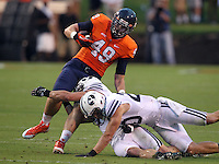 during the first half of the game in Charlottesville, Va. Virginia defeated Brigham Young 19-16. Photo/Andrew Shurtleff