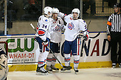 March 13, 2009:  David Brine (34), Karl Stewart (19), and Michal Repik (26) of the Rochester Amerks, AHL affiliate of the Florida Panthers, celebrate a goal in the third period during a game at the Blue Cross Arena in Rochester, NY.  Toronto defeated Rochester 4-2.  Photo copyright Mike Janes Photography 2009