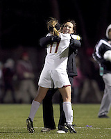 "Boston College defender Hannah Cerrone (11) celebrates her goal/victory with Boston College head coach, Alison Foley. In overtime, Boston College defeated University of Washington, 1-0, in NCAA tournament ""Elite 8"" match at Newton Soccer Field, Newton, MA, on November 27, 2010."
