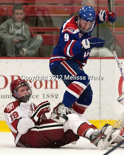 Jimmy Vesey (Harvard - 19), Terrence Wallin (UML - 9) - The visiting University of Massachusetts Lowell River Hawks defeated the Harvard University Crimson 5-0 on Monday, December 10, 2012, at Bright Hockey Center in Cambridge, Massachusetts.