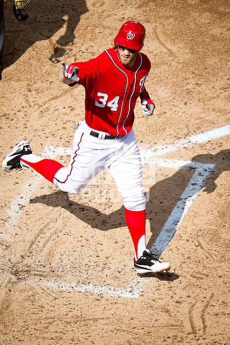 Washington Nationals outfielder Bryce Harper (34) crosses home plate after hitting a home run during a game against the Miami Marlins at Nationals Park in Washington, DC on September 8, 2012.