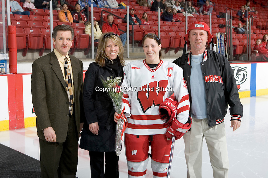MADISON, WI - FEBRUARY 11: Bobbi-Jo Slusar #10 of the Wisconsin Badgers women's hockey team poses for a photo prior to the game against the Ohio State Buckeyes at the Kohl Center on February 11, 2007 in Madison, Wisconsin. The Badgers beat the Buckeyes 3-2. (Photo by David Stluka)