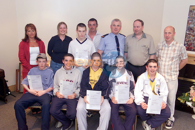 Redeemer Resource centre presentation..I.T. Skills O.C.R. accreditation.Front Left to right.Conor Brady, Brian McCabe, Thomas Turley, Thomas english and Thomad McCabe, Back, Rachel McEvoy (Tutor), Grainne Lee ( Volenteer) James Heeney receipient, John Kearney (Worker), Inspector Leo McGinn and Vincent McGrory (Cordinator)..Photo Fran Caffrey/Newsfile.ie..This picture has been sent to you by:.Newsfile Ltd,.3 The View,.Millmount Abbey,.Drogheda,.Co Meath..Ireland..Tel: +353-41-9871240.Fax: +353-41-9871260.GSM: +353-86-2500958.ISDN: +353-41-9871010.IP: 193.120.102.198.www.newsfile.ie..email: pictures@newsfile.ie..This picture has been sent by Fran Caffrey.francaffrey@newsfile.ie