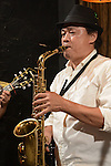 DC Stage, Kaohsiung -- Saxophonist Morlun of Smalls Jazz Combo performing on stage.