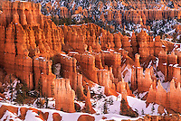 730750127 winter sunrise lights up the reddish sandstone hoodoos seen from sunrise point in bryce canyon national park in utah