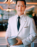 CHINA, Macau, Asia, Grand Lapa Hotel, Bella Vista Cafe, Waiter holding saucers at Bella Vista Cafe