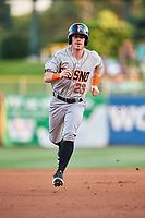 Drew Ferguson (23) of the Fresno Grizzlies hustles to third base against the Salt Lake Bees at Smith's Ballpark on September 3, 2017 in Salt Lake City, Utah. The Bees defeated the Grizzlies 10-8. (Stephen Smith/Four Seam Images)