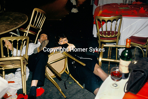'WARWICKSHIRE HUNT BALL', DRUNKEN COUPLE LAUGH AS THEY BOTH FALL BACKWARDS OFF THEIR CHAIRS & ROLL AROUND THE FLOOR AT THE END OF THE PARTY AT TYSOE MANOR