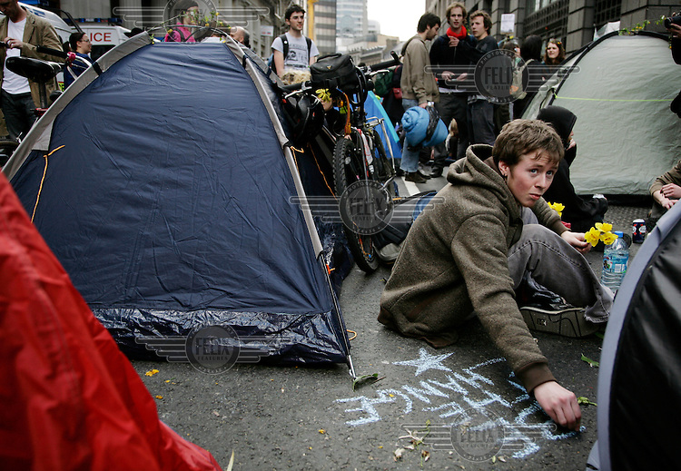 Climate Camp demonstrators take over Bishopsgate as thousands of protestors descended on the City of London ahead of the G20 summit of world leaders to express anger at climate change and the economic crisis, which many blame on the excesses of capitalism.