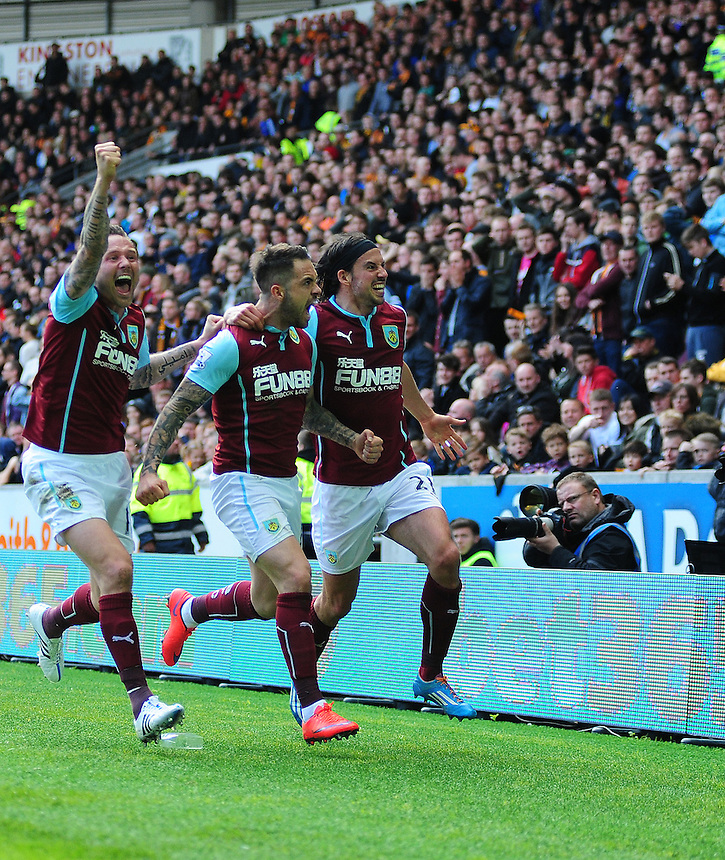 Burnley's Danny Ings, centre, celebrates scoring the opening goal with team-mates Scott Arfield, left, and George Boyd<br /> <br /> Photographer: Chris Vaughan/CameraSport<br /> <br /> Football - Barclays Premiership - Hull City v Burnley - Saturday 9th May 2015 - Kingston Communications Stadium - Hull<br /> <br /> &copy; CameraSport - 43 Linden Ave. Countesthorpe. Leicester. England. LE8 5PG - Tel: +44 (0) 116 277 4147 - admin@camerasport.com - www.camerasport.com