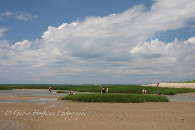 People enjoying the beach at low tide. Cape Cod, MA