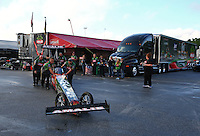 May 18, 2014; Commerce, GA, USA; Crew members for NHRA top fuel driver Terry McMillen push their car out of their pits during the Southern Nationals at Atlanta Dragway. Mandatory Credit: Mark J. Rebilas-USA TODAY Sports