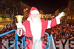 Santa Claus waves to the crowd at the switching on of the Christmas lights in Killarney on Friday night.