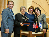 Several hundred people gather Sunday, April 23, 2017 at Washington, DC's Adas Israel Congregation to commemorate Yom Hashoah, Holocaust Remembrance Day, with the synagogue's annual Garden of the Righteous ceremony, honoring non-Jews who risked their lives to save Jews during the Holocaust. This year's honoree was the Veseli family from Albania, who sheltered two Jewish families in Kruja, Albania during World War II.  Adas Israel Congregation President Debby Joseph presents the award to the Veseli family, (seen L to R) Bujar Veseli, Drita Veseli, Joseph, and Ermira Hoxha.<br /> Credit: Ron Sachs / CNP