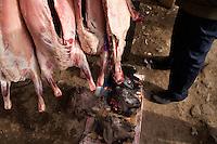 Goat heads lay near carcasses at a butcher stand at the Sunday Animal Market outside Kashgar, Xinjiang, China.