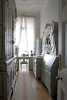 The small study/home office is dominated by a vast wooden cupboard and has a desk tucked away in front of the window
