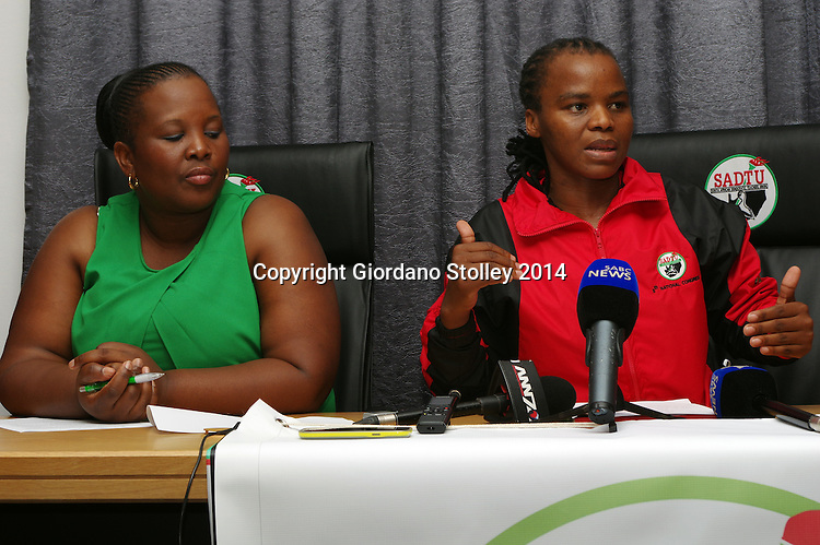 DURBAN - 25 November 2014 - Nomorashiya Caluza (right), the acting KwaZulu-Natal provincial secretary for the SA Democratic Teachers Union speaks at a press conference, where she said the union welcomed the education department's decision to establish a committee to investigate irregular expenditure. Loking is Zodwa Zwane, the provincial acting chairperson of the union. Picture: Allied Picture Press/APP