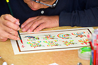 Chinese man drawing calligraphy