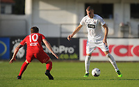 Partizan Belgrade's Strahinja Pavlovic under pressure from Connah's Quay Nomads' Jamie Insall<br /> <br /> Photographer Kevin Barnes/CameraSport<br /> <br /> UEFA Europa League 2nd Qualifying Round 1st Leg - Connah's Quay Nomads v Partizan Belgrade - Thursday July 25th 2019 - Belle Vue Stadium - Rhyl<br />  <br /> World Copyright © 2019 CameraSport. All rights reserved. 43 Linden Ave. Countesthorpe. Leicester. England. LE8 5PG - Tel: +44 (0) 116 277 4147 - admin@camerasport.com - www.camerasport.com