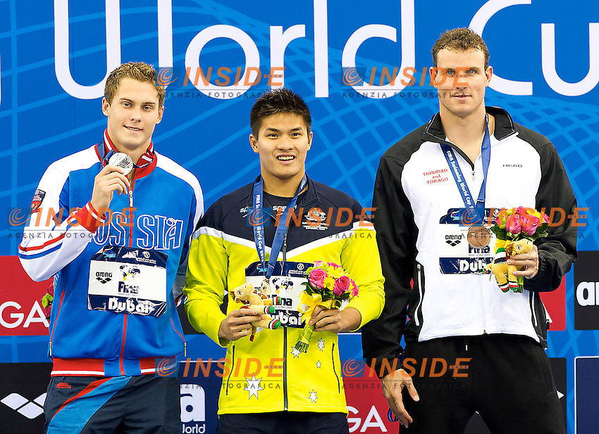100 individual medley men<br /> from left MOROZOV Vladimir RUS Russia, TO Kenneth AUS Australia,  BOVELL George TRI Trinidad <br /> FINA Swimming World Cup 2013<br /> Dubai 16 - 18 October 2013<br /> Day 1 October 17 Finals<br /> Hamdan bin Mohammed bin Rashid Sport Complex<br /> Photo G.Scala/Insidefoto