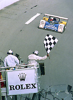 The #4 Riley & Scott Oldsmobile of Wayne Taylor, Scott Sharp and Jim Pace takes the checkered flag to win the 24 Hours of Daytona, IMSA race, Daytona INternational Speedway, Daytona Beach , FL, February 4, 1996.  (Photo by Brian Cleary/www.bcpix.com)