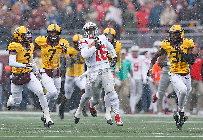 Ohio State Buckeyes quarterback J.T. Barrett (16) leaves the Gophers defenses in the dust as he races for the Buckeyes first TD against Minnesota at TCF Bank Stadium on November 15, 2014. (Chris Russell/Dispatch Photo)