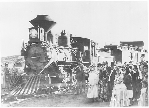 &quot;The Texas Rangers&quot; movie train with old T-12 #168 dressed up as &quot;Montezuma&quot; is at Espanola with many people dressed in period costume for the movie.  A good 3/4 frontal view of the engine.<br /> D&amp;RGW  Espanola, NM  1935