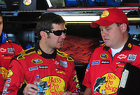 Apr 17, 2009; Avondale, AZ, USA; NASCAR Sprint Cup Series driver Martin Truex Jr (left) talks with crew chief Kevin Manion during practice for the Subway Fresh Fit 500 at Phoenix International Raceway. Mandatory Credit: Mark J. Rebilas-