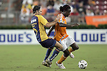 25 July 2007:  Joseph Ngwenya (r) of the Dynamo is fouled by Duilio Davino (5) of Club America.  Club America was defeated by the Houston Dynamo 0-1 at Robertson Stadium in Houston, Texas, in a first round SuperLiga 2007 match.