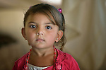 Three-year old Hiba Al-Hariri lives in the Zaatari refugee camp near Mafraq, Jordan. Her family fled fighting in Daraa, Syria, in 2013, crossing the border into Jordan without appropriate paperwork. They'd like to move elsewhere, but aren't permitted to leave the camp. <br /> <br /> Established in 2012 as Syrian refugees poured across the border, the Zaatari camp held more than 80,000 refugees by 2015, and was rapidly evolving into a permanent settlement. ACT Alliance member agencies provide a variety of services to refugees living in the camp.<br /> <br /> Parental consent obtained.