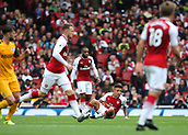 1st October 2017, Emirates Stadium, London, England; EPL Premier League Football, Arsenal versus Brighton; Alexis Sanchez of Arsenal picks himself up off the floor after a challenge