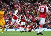 1st October 2017, Emirates Stadium, London, England; EPL Premier League Football, Arsenal versus Brighton; Alexis Sanchez of Arsenal picks himself up off the floor after a challenge