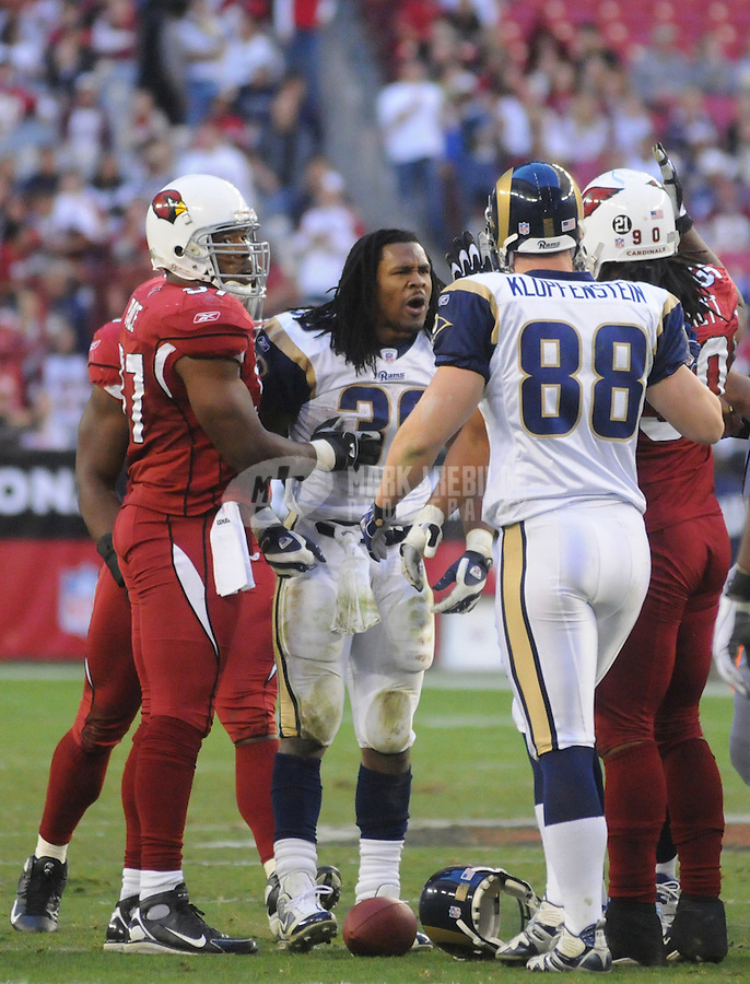 Dec. 30, 2007; Glendale, AZ, USA; St Louis Rams running back Steven Jackson (39) confronts Arizona Cardinals defensive tackle Darnell Dockett (90) in the fourth quarter at University of Phoenix Stadium. Arizona defeated St Louis 48-19. Mandatory Credit: Mark J. Rebilas-US PRESSWIRE