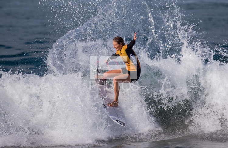Huntington Beach, CA - Saturday August 4, 2018: Stephanie Gilmore in action during a World Surf League (WSL) World Championship Tour (WCT) Round 3 heat at the 2018 Vans U.S. Open of Surfing on South side of the Huntington Beach pier.