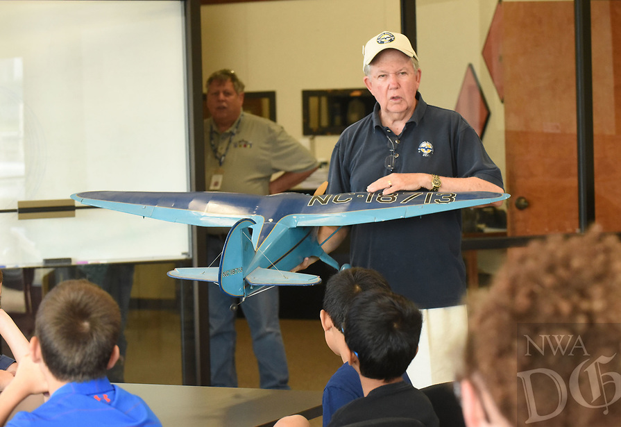 NWA Democrat-Gazette/FLIP PUTTHOFF <br /> FIRST FLIGHT<br /> Dave Bowman, retired United States Air Force pilot, explains Saturday June 9 2018 the basics of flight during the Young Eagles aviation event at Fayetteville Executive Airport. The trip was Ethan's first flight. Members of the Experimental Aircraft Association host Young Eagles events to introduce youngsters to flying and perhaps a career in aviation. Kids learn flight basics in a classroom session then get a free airplane ride, said Russ Smith with the association. Pilots volunteer their time and aircraft for the events, he said.