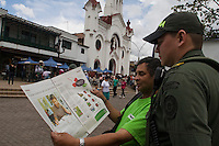 A resident show a newspaper with the picture of french journalist Romeo Langlois after a the burial of the Colombian policeman Juan Rodriguezin the church of the town of Guarne. Darío Rodríguez died together with three soldiers in a clash with the Revolutionary Forces of Colombia (FARC) last April 29, 2012, the patrol was an ambush in the province Caqueta, in this procession there was travelling the French journalist Romeo Langlois, who is missing and apparently it has been kidnapped by the FARC. In province of Guarne, Antioquia, Colombia. 30/04/2012. Photo by Fredy Amariles/VIEWpress.