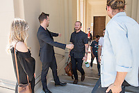 From left, Lauren Paul and Aaron Paul greet their friend, Tedx speaker Jedidiah Jenkins, outside Choi Auditorium. The two came to see Jenkins' talk.<br />