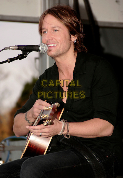KEITH URBAN.performs a free acoustic set at the Verizon Wireless Store, Cool Springs, Tennessee, USA, .30th October 2009..music concert gig live on stage performing half length guitar microphone black top shirt singing playing tattoo                .CAP/ADM/EM.©Eddie Malone/Admedia/Capital Pictures