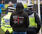 © Joel Goodman - 07973 332324 . 20/01/2018. Doncaster, UK. Far-right street protest movement , the English Defence League ( EDL ) , hold a demonstration , opposed by anti-fascists , including Unite Against Fascism ( UAF ) in a park in Hexthorpe in Doncaster . EDL supporters chanted anti-Roma slogans as they marched through the town . Photo credit : Joel Goodman