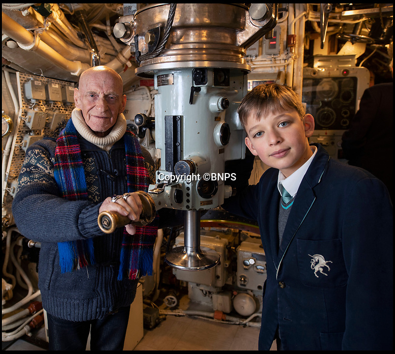 BNPS.co.uk (01202)558833Pic:  PhilYeomans/BNPS<br /> <br /> Wally Wickham with 11 year-old Tommy Winter - they both lost relatives on HMS Triumph.<br /> <br /> The relatives of the crew of a lost British submarine have gathered together to mark the 77th anniversary of their deaths and are determined to finally track down their watery tomb...<br /> <br /> Poignantly, the families met up on HMS Alliance, the only remaining WW2 era British submarine based at the Royal Navy's submarine museum in Gosport.<br /> <br /> Royal Navy submarine HMS Triumph is thought to have been sunk by a German mine whilst on a top secret mission in the Aegean on the 9th of January 1942, but their final resting place has never been found.<br /> <br /> They were traced and brought together by Gav Don, who is on a one-man mission to find the wreck of the submarine that is somewhere in the <br /> Aegean Sea.<br /> <br /> The former Royal Navy officer's uncle Robert Douglas-Don died with the rest of the 62-strong crew in January 1942.<br /> <br /> At the time the submarine was on a top secret mission to recover 18 escaped Allied soldiers from a remote Greek island.