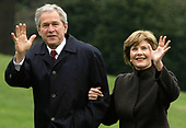 United States President George W. Bush, left, and first lady Laura Bush wave to the media as they return to the White House with from their trip to Eastern Europe April 6, 2008 in Washington, DC. Bush couldn't reach an agreement with Russian President Vladimir Putin on putting coverage of a missile defense system in Eastern Europe. <br /> Credit: Alex Wong / Pool via CNP