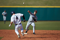 Sam Flamini (14) of the Xavier Musketeers makes a throw to first base against the while Connor Klemann (4) of the Penn State Nittany Lions hustles towards second base at Coleman Field at the USA Baseball National Training Center on February 25, 2017 in Cary, North Carolina. The Musketeers defeated the Nittany Lions 10-4 in game one of a double header. (Brian Westerholt/Four Seam Images)