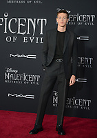"LOS ANGELES, USA. September 30, 2019: Harris Dickinson at the world premiere of ""Maleficent: Mistress of Evil"" at the El Capitan Theatre.<br /> Picture: Jessica Sherman/Featureflash"