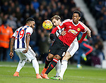 Anthony Martial of Manchester United held by Craig Dawson of West Bromwich Albion - English Premier League - West Bromwich Albion vs Manchester Utd - The Hawthorns Stadium - West Bromwich - England - 6th March 2016 - Picture Simon Bellis/Sportimage