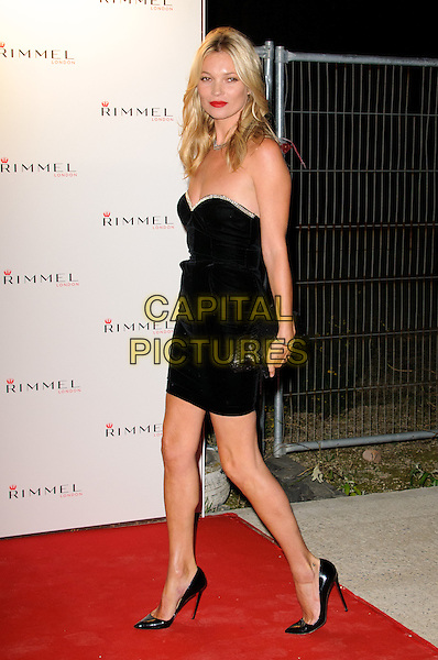 Kate Moss.The Rimmel London party, Battersea Power Station, London, England..September 15th, 2011.full length black strapless dress clutch bag side.CAP/CJ.©Chris Joseph/Capital Pictures.
