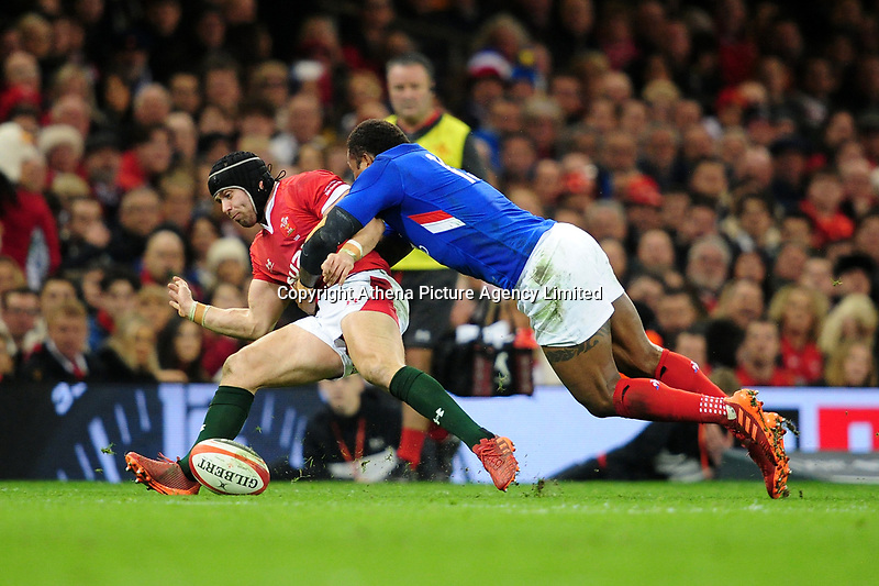 Leigh Halfpenny of Wales is tackled by Virimi Vakatawa of France during the Guinness Six Nations Championship Round 3 match between Wales and France at the Principality Stadium in Cardiff, Wales, UK. Saturday 22 February 2020