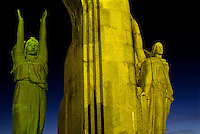 Stone statues of the Death Memorial Monument at night, Marseille, France.